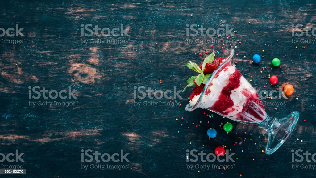 Strawberry Creamy Dessert with Mint. On a wooden background. Top view. Copy space. - Royalty-free Berry Stock Photo
