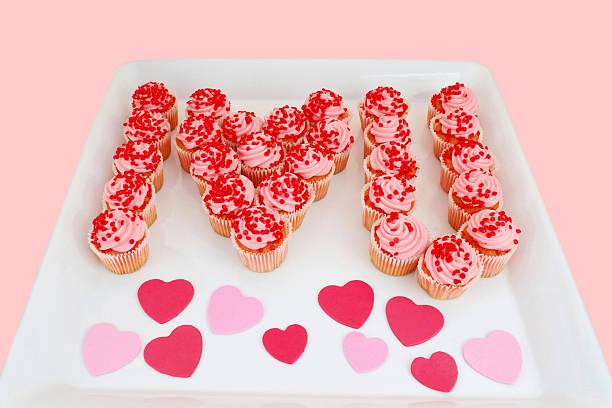 Strawberry Cupcakes Spell I Love U on Tray stock photo