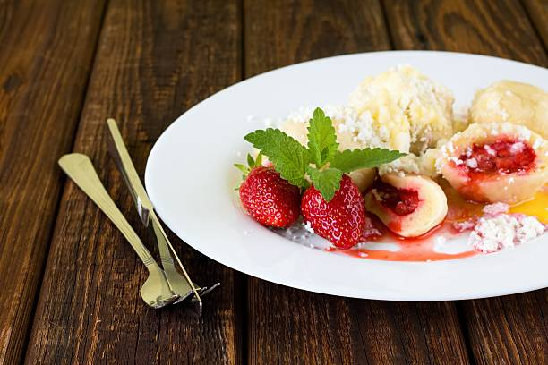 Strawberry dumplings on white plate stock photo