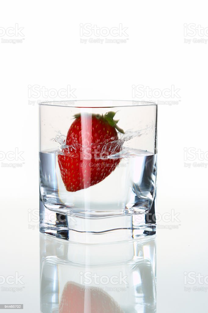 strawberry falling in waterglass royalty-free stock photo