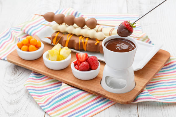 strawberry fondue strawberry fondue with various fruits chocolate fondue stock pictures, royalty-free photos & images
