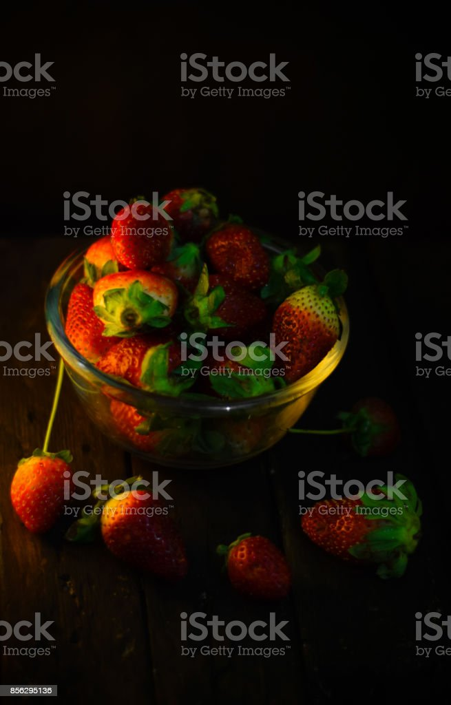 Strawberry. Fresh strawberry. Red strewberry. Strawberry in wood vertical stock photo