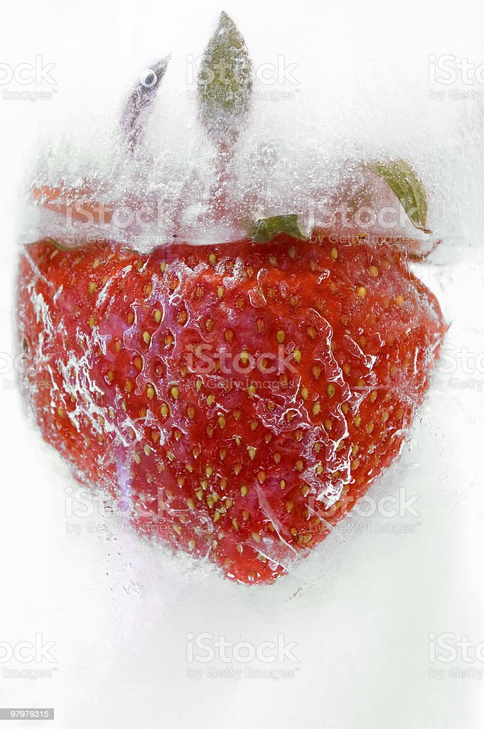 Strawberry frozen in ice royalty-free stock photo