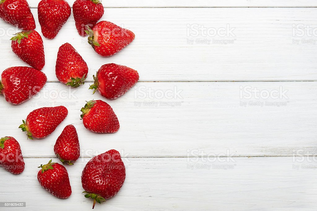 strawberry fruits on wooden background stock photo