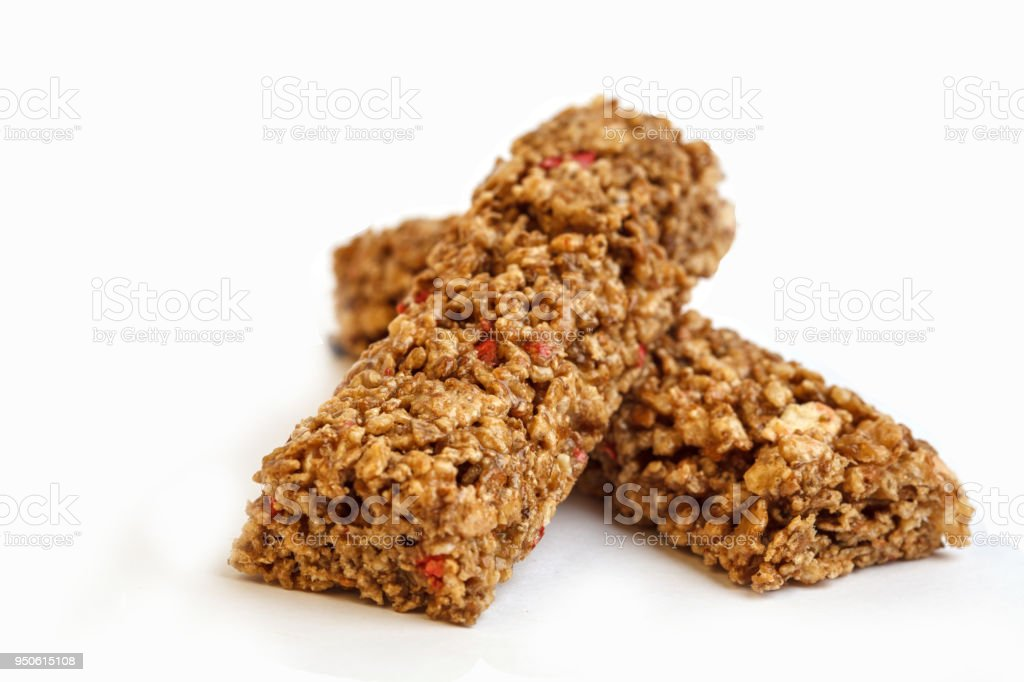 Strawberry granola bars isolated on white background. Healthy sweet dessert snack. Cereal granola bar with nuts and berries stock photo