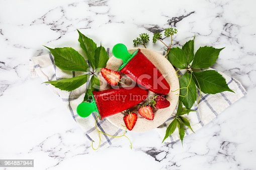 Strawberry Homemade Ice Cream Sorbet On The Marble Kitchen Table Stock Photo & More Pictures of Berry