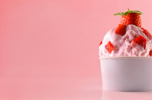 Strawberry ice cream cup on table isolated close up stock photo