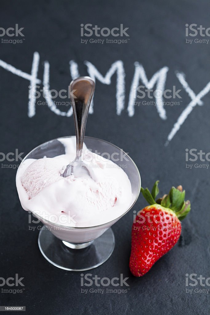Strawberry ice cream in glass bowl royalty-free stock photo