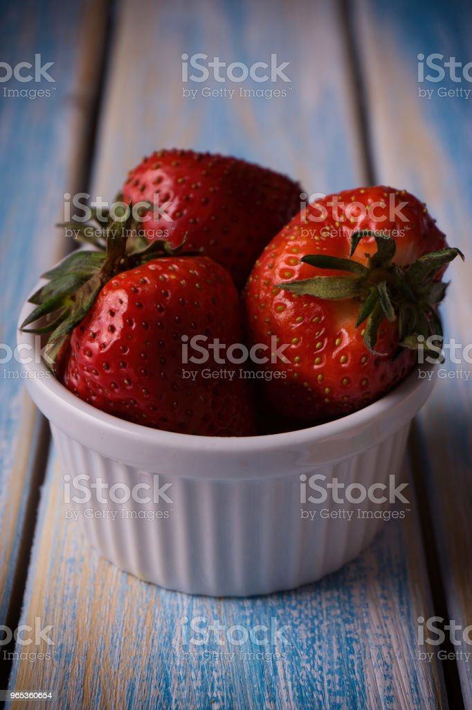 strawberry in a bowl on a wooden background royalty-free stock photo