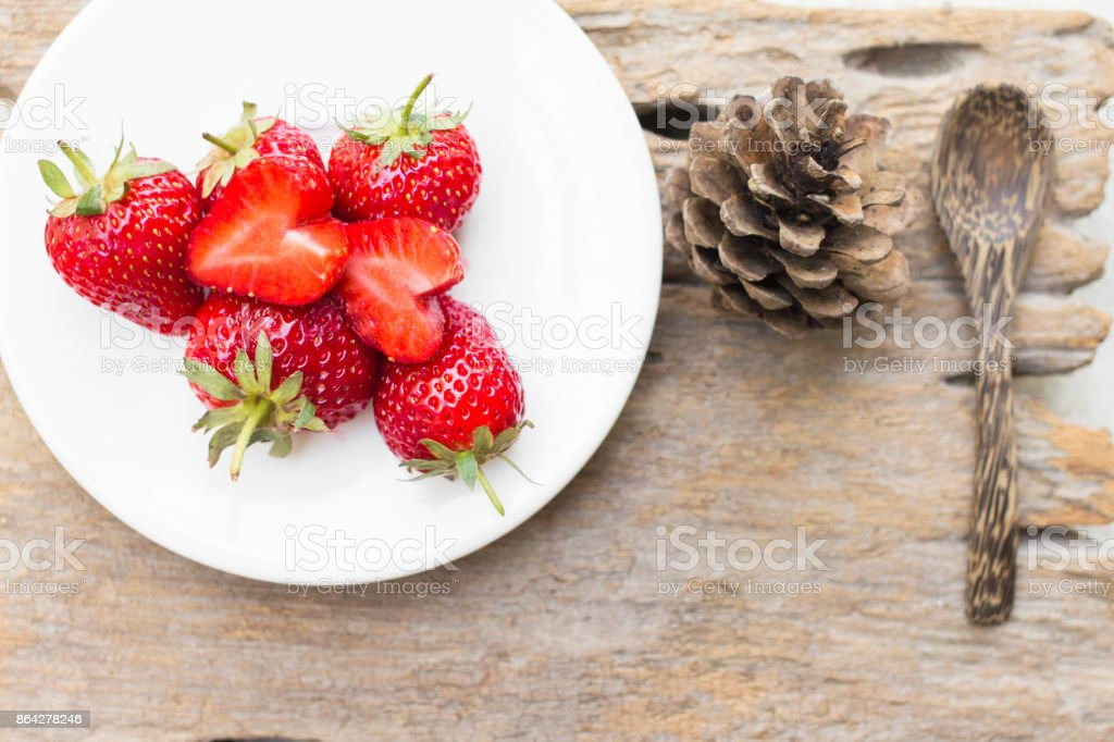 strawberry in a dish placed on the wood royalty-free stock photo