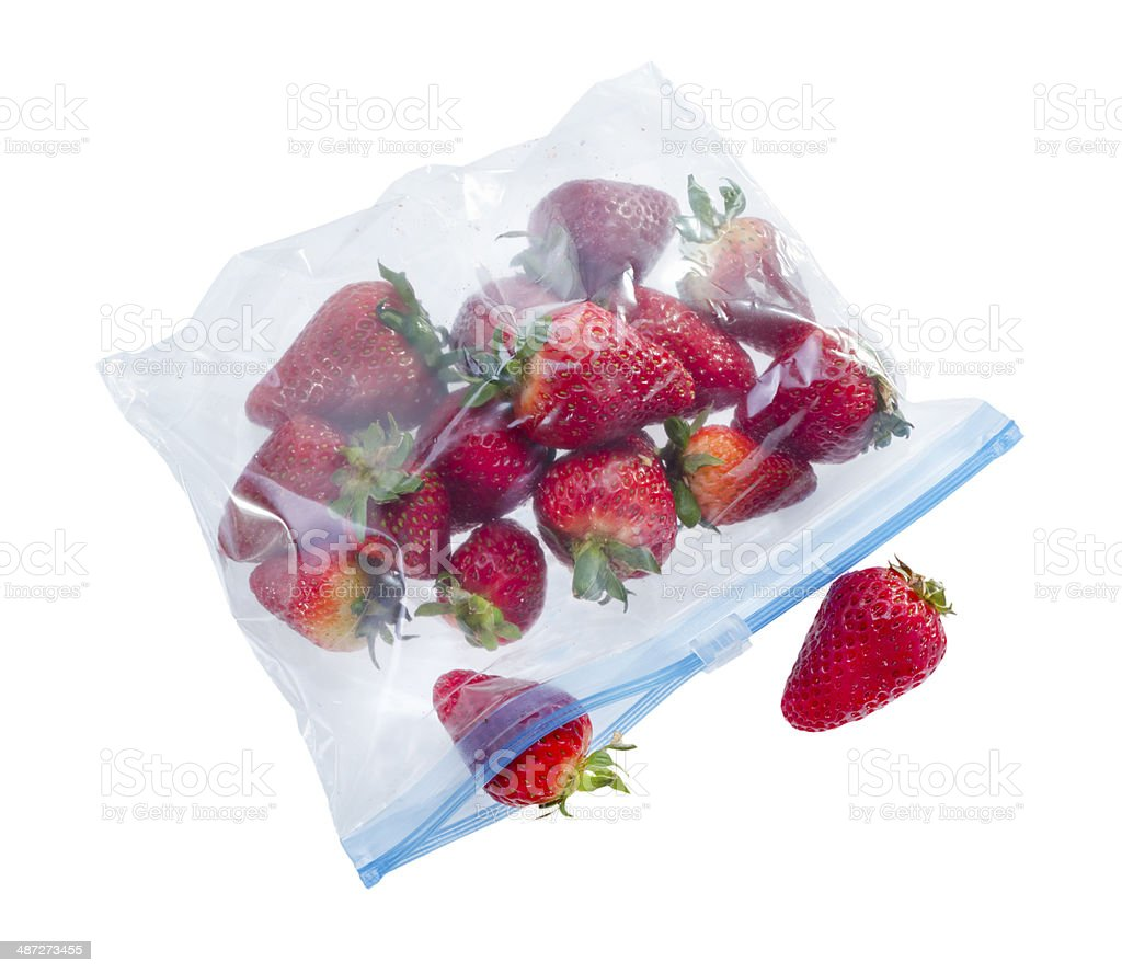 Strawberry in clear plastic bag stock photo