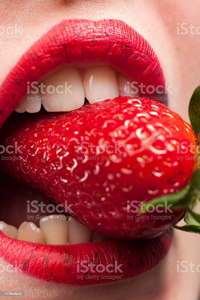 Strawberry in the mouth royalty-free stock photo