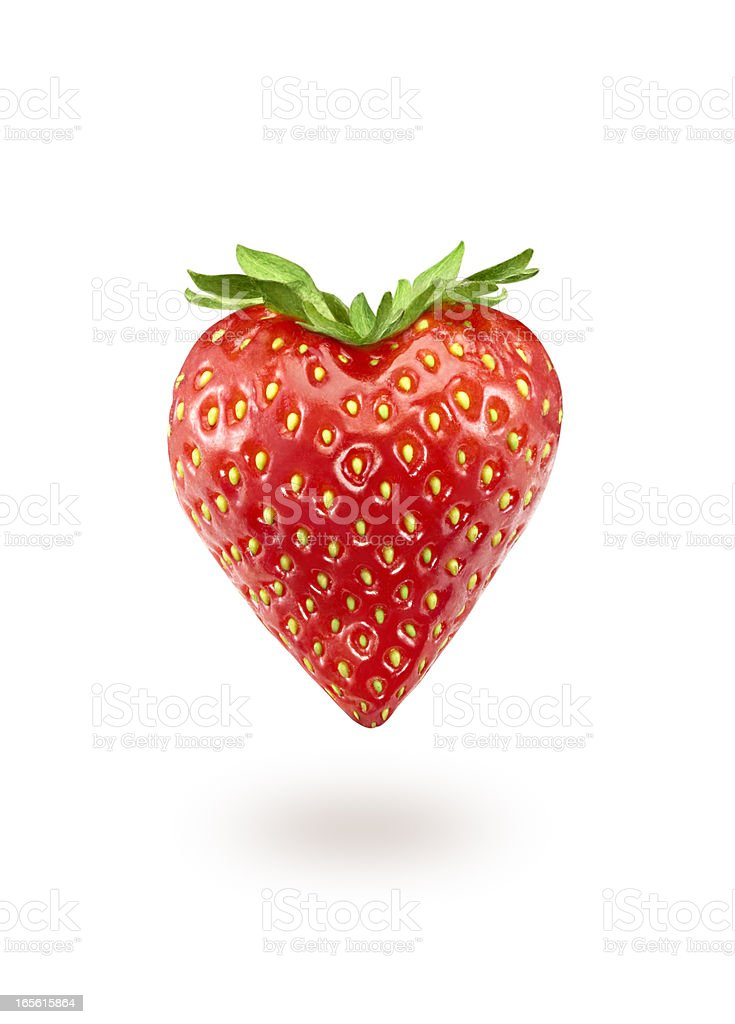 A strawberry in the shape of a heart foto