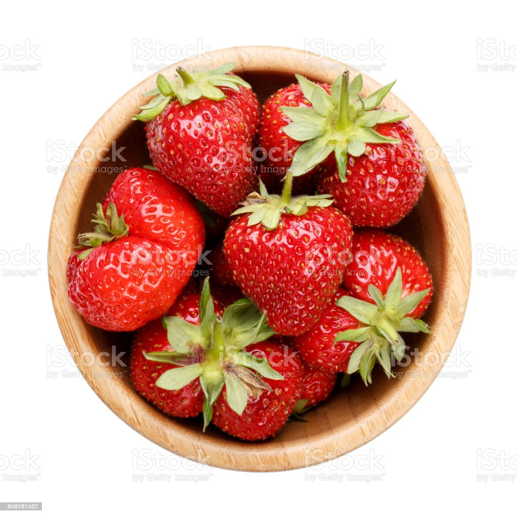 Strawberry in wooden bowl isolated on white background. Top view. stock photo