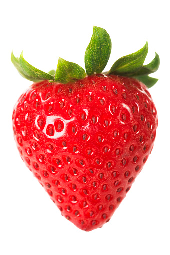 A ripe strawberry with leaves isolated against a white backgorund