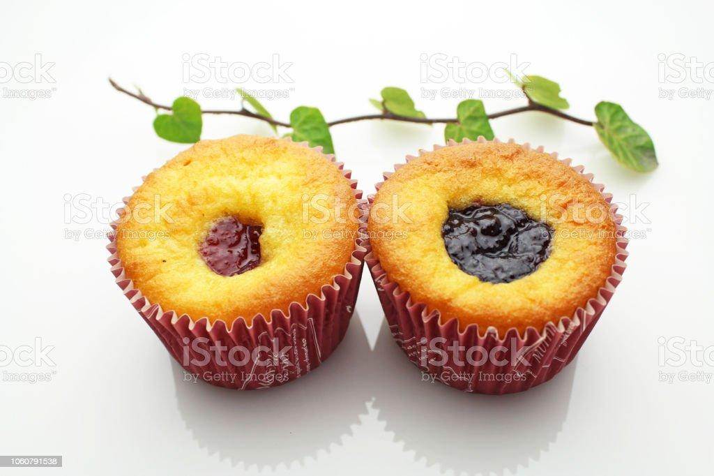 Strawberry jam and blueberry jam muffins stock photo