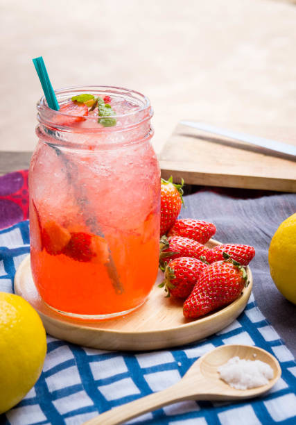 Strawberry juice and lemon soda juice mixed with soda. Add flavor Improve the health of the body can do at home. Juice on empty days Or party stock photo