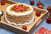 Cake with glazed strawberry kiwi fruit toppings