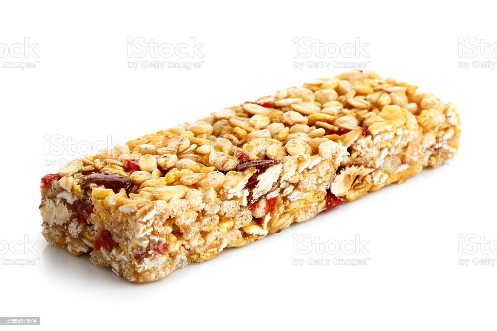Strawberry, oat and nut bar isolated on white. photo libre de droits