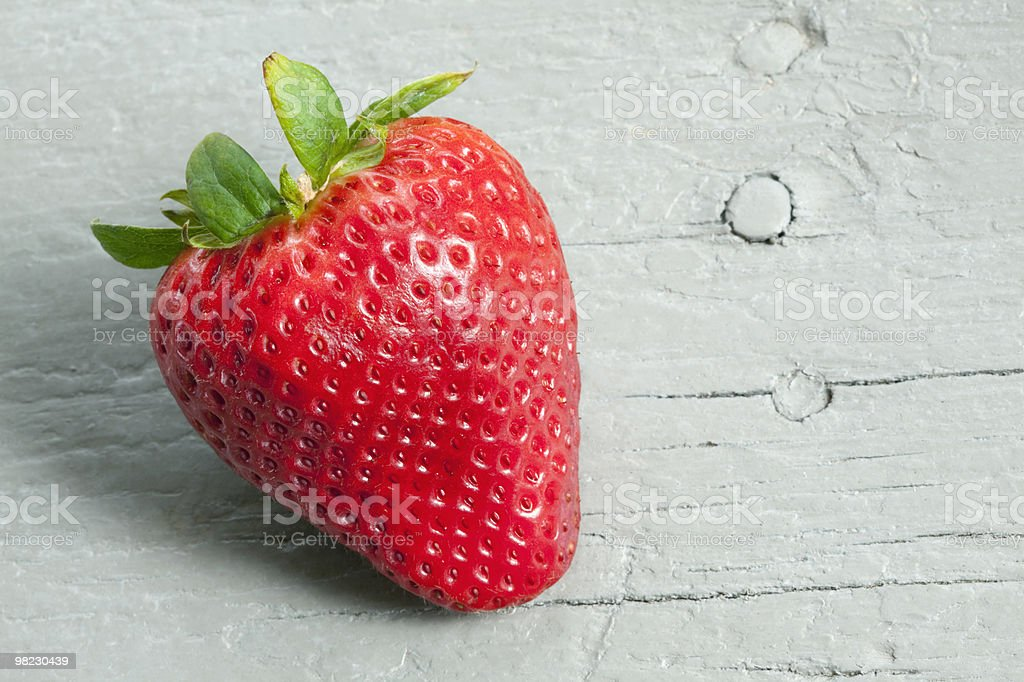 Strawberry on gray wooden table royalty-free stock photo