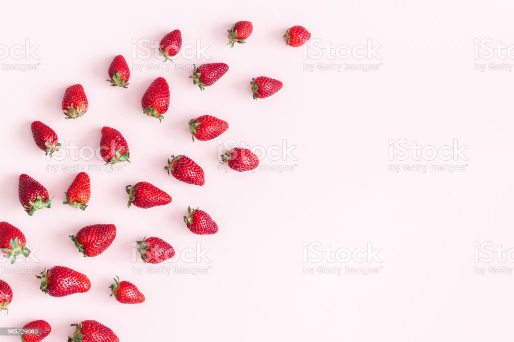 Strawberry on pastel pink background. Flat lay, top view - Royalty-free Above Stock Photo