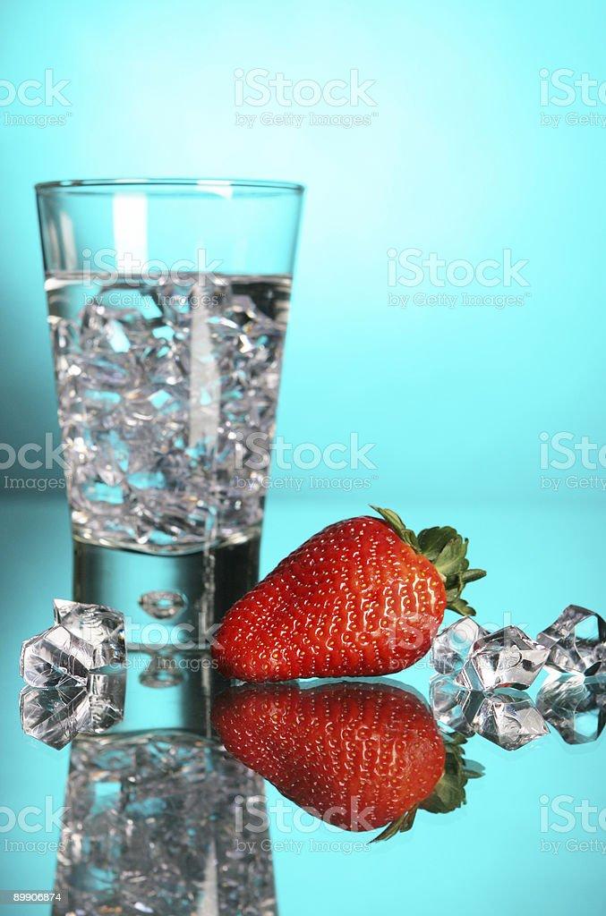 strawberry on turquoise background royalty-free stock photo