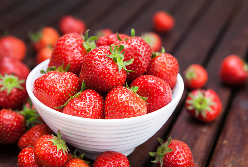 Strawberry on wooden background. Copy space