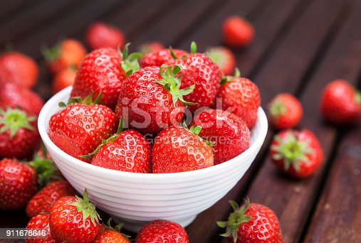 Fresh strawberries on wooden background. Copy space