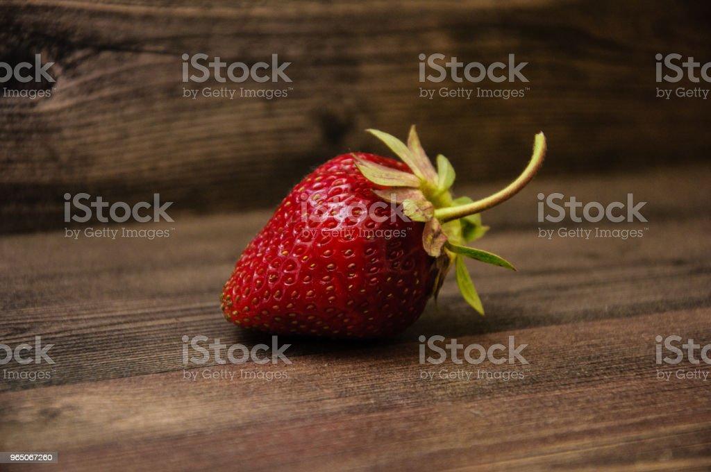 Strawberry on wooden background zbiór zdjęć royalty-free