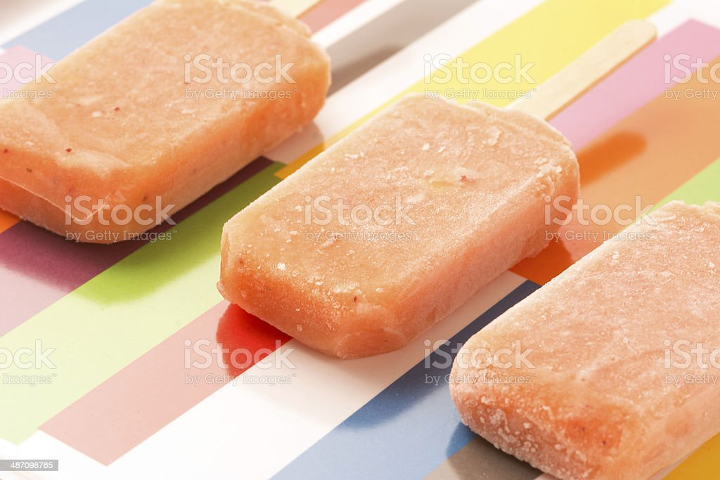 Strawberry, Orange, Pineapple, Mango Fruit Popsicles Shot From A stock photo