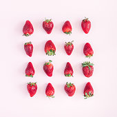 Strawberry pattern on pink background. Flat lay, top view, square