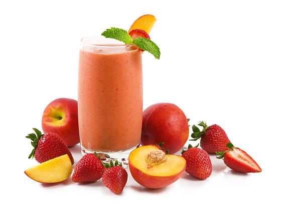 Strawberry peach smoothie stock photo
