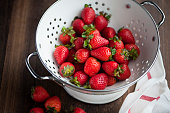 close up of strawberries in the colander