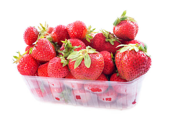 strawberry strawberry in  punnet in front of white background fruit carton stock pictures, royalty-free photos & images