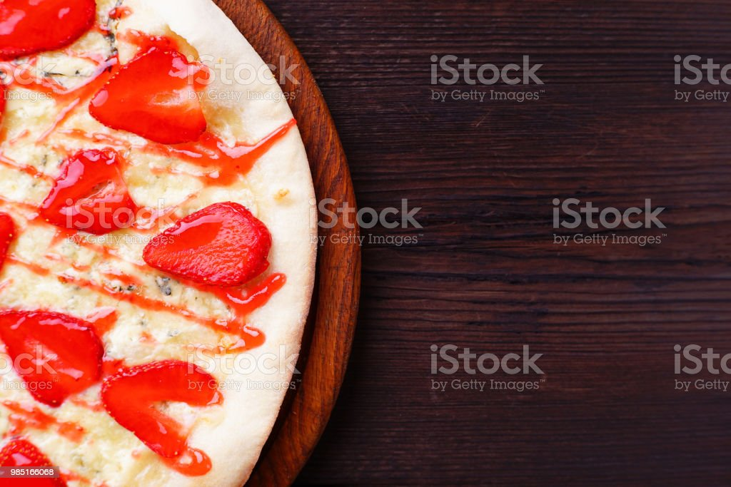 strawberry pizza background with free space stock photo