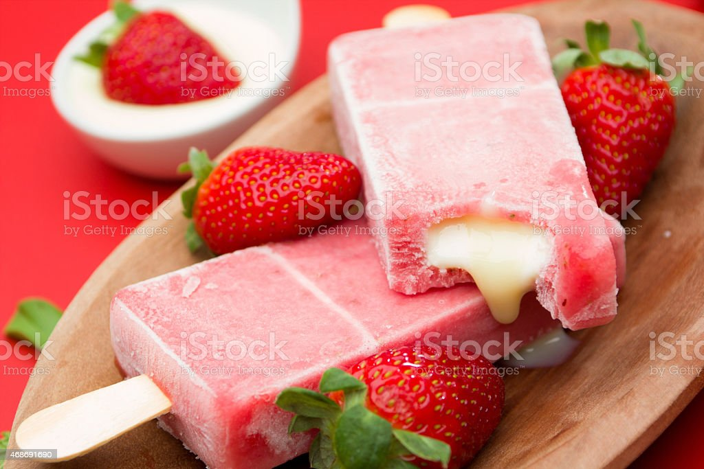 Strawberry Popsicles with gooey filling stock photo