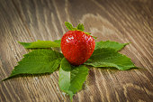 Strawberry. Ripe red strawberries on a wooden table. Healthy food photo.
