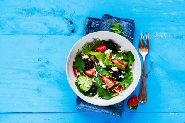 Strawberry salad bowl stock photo