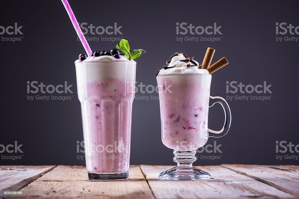 Strawberry shake with blueberries, mint, cinnamon sticks and cloves stock photo