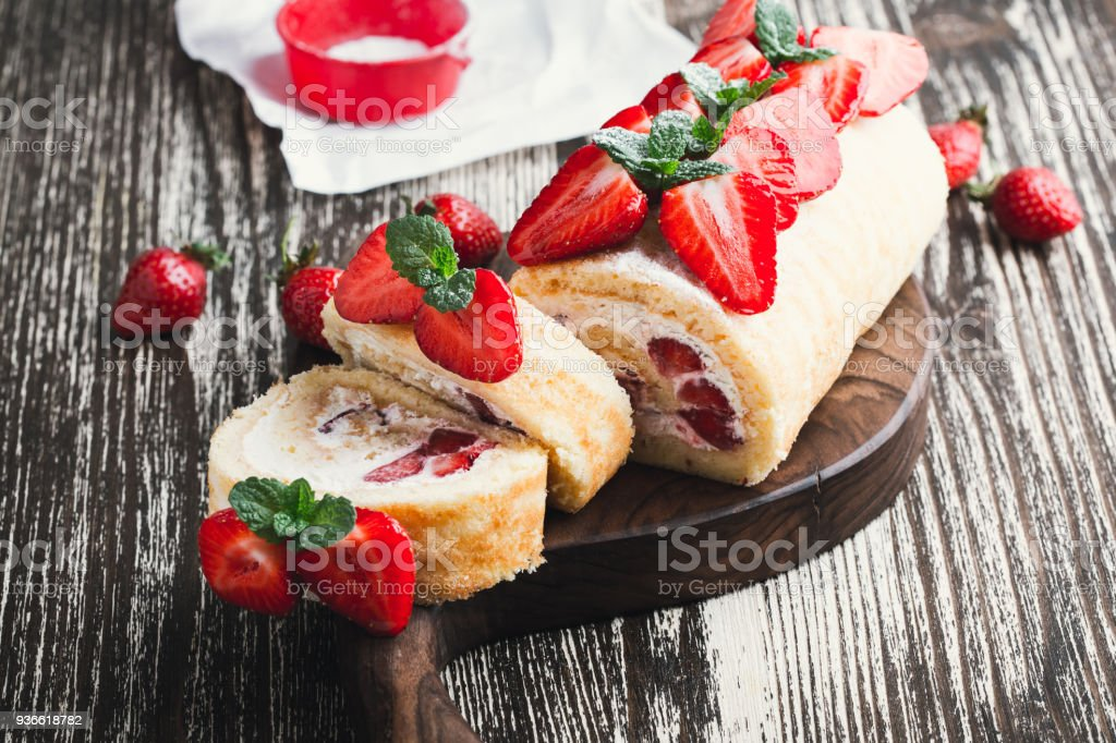 strawberry shortcake cake roll with cream cheese whipped cream stock photo