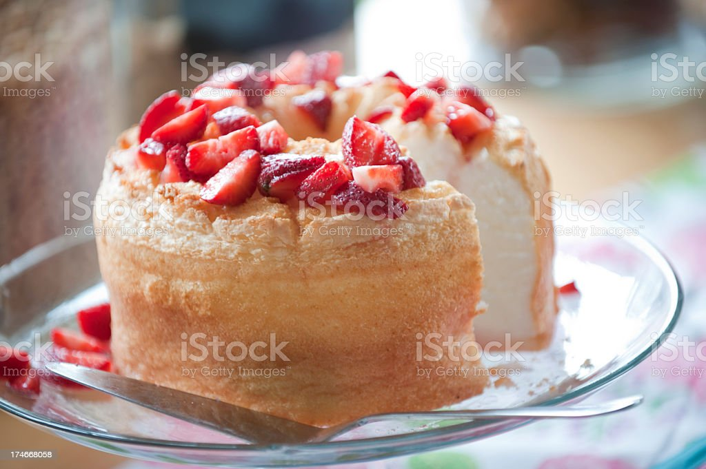 A strawberry shortcake with one piece missing royalty-free stock photo