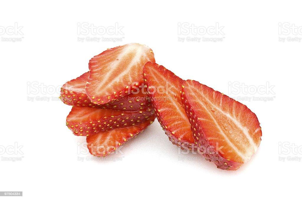 Strawberry slices on white background Strawberry slices cut on a white background. Berry Fruit Stock Photo