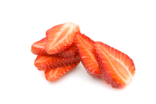 Strawberry Slices On White Background Stock Photo - Download Image Now