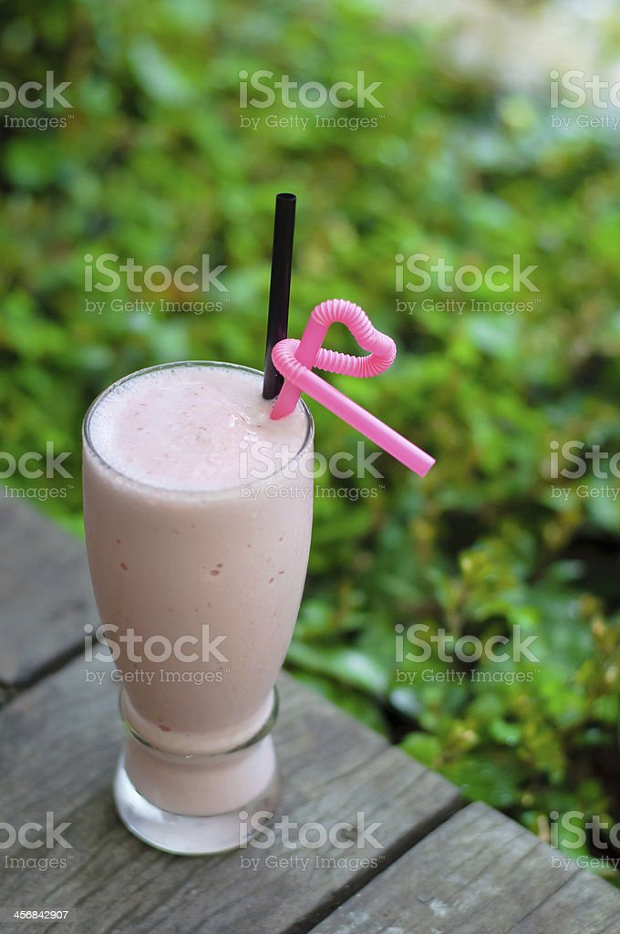 Strawberry smoothie with fresh berries royalty-free stock photo