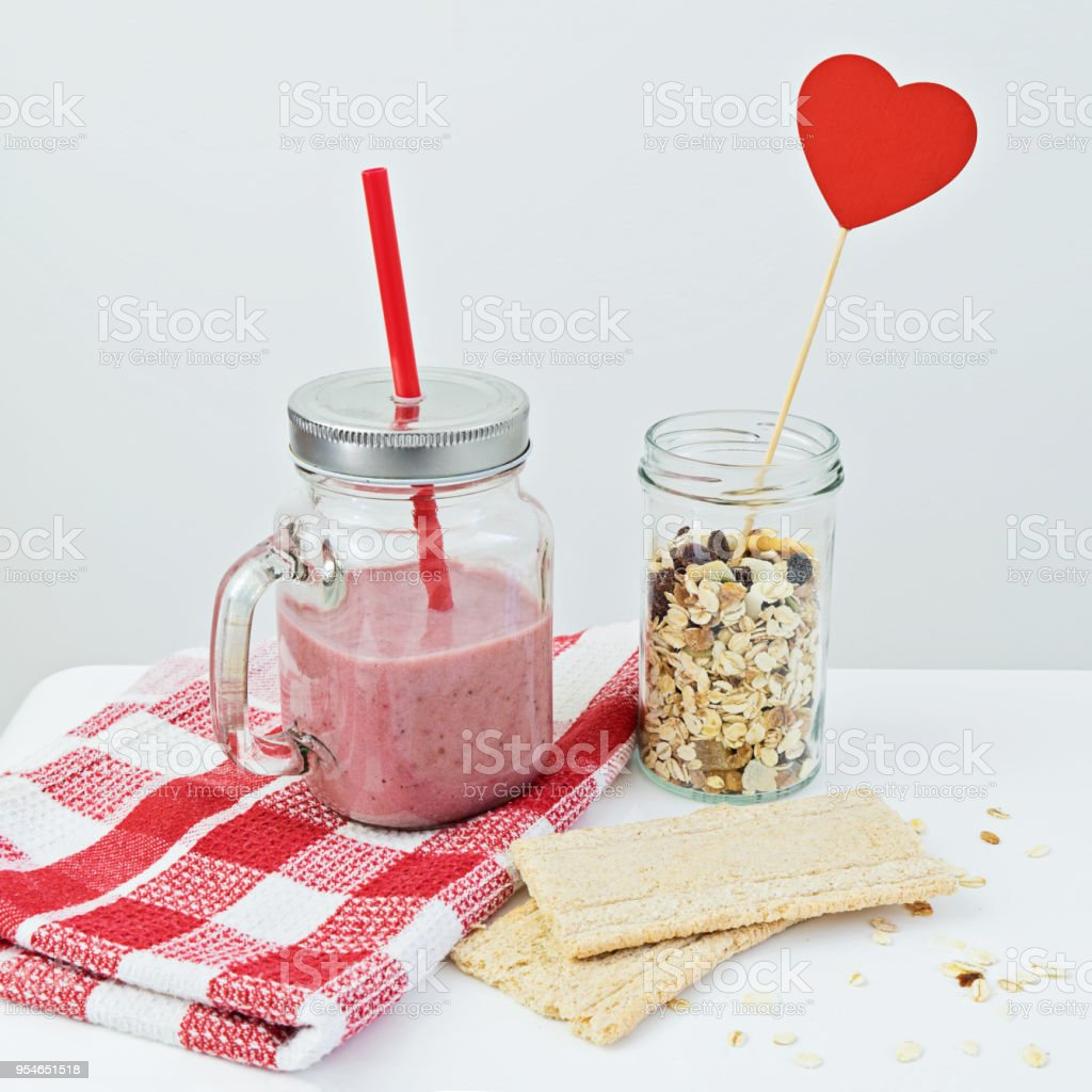 Strawberry smoothie with granola and cracker stock photo