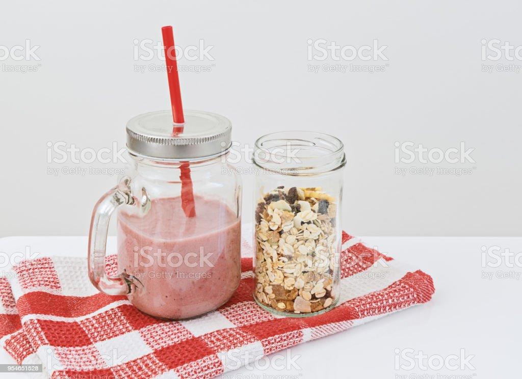 Strawberry smoothie with granola stock photo