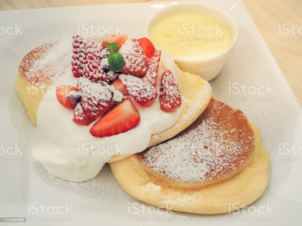 Strawberry Souffle Pancakes. Strawberry Cheese Souffle Pancakes with Fondue. Baked Stock Photo