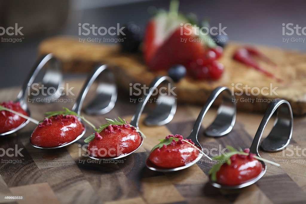 Strawberry soup spoon and berries stock photo