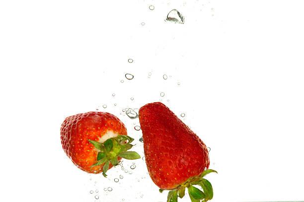 strawberry splash to water stock photo