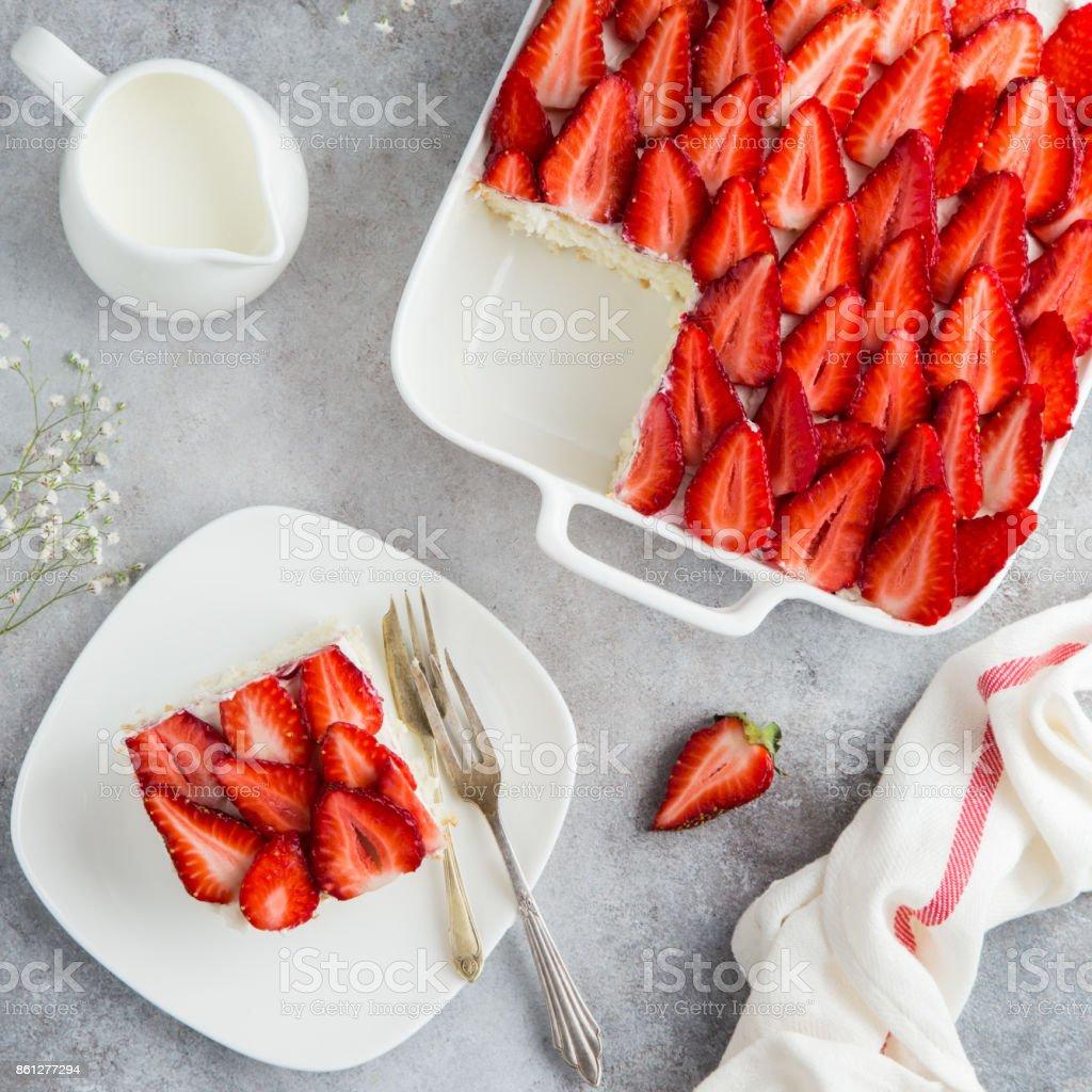 strawberry sponge cake on white baking dish, top view stock photo